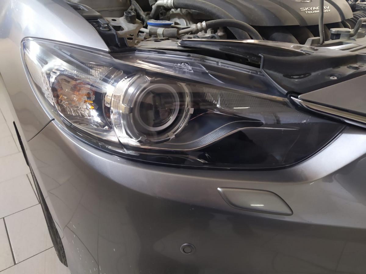 Тонировка и обклейка фар Mazda 6